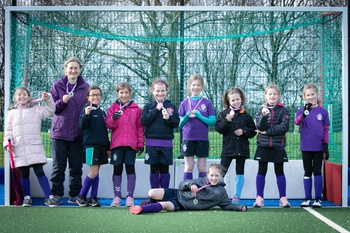 The team with their silver medals and big smiles - well played!
